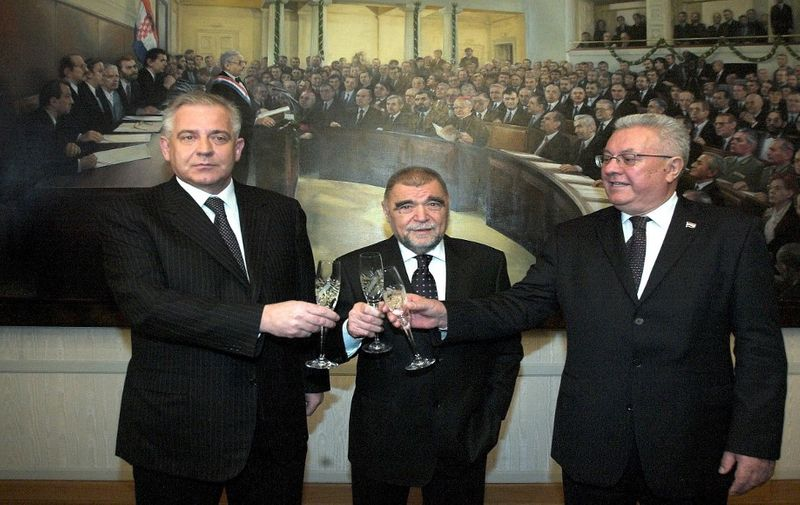 (From L) Croatian Prime ¨Minister-designate Ivo Sanader, President Stipe Mesic and new Parliament Speaker Luka Bebic toast ahead of an inaugural session of the parliament after the November 25 legislative elections 11 January 2008 in Zagreb. Croatia's new parliament held on Friday an inaugural session during which a veteran member of the conservatives who won most of the votes in November elections was elected its speaker. AFP PHOTO STRINGER (Photo by AFP)