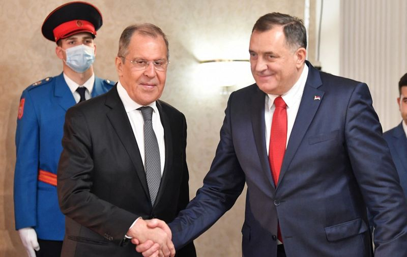Russian Foreign Minister, Sergey Lavrov (L) shakes hands after meeting with chairman of Bosnia and Herzegovina's tripartite presidency, Milorad Dodik (R), in East-Sarajevo, late on December 14, 2020. - Minister Lavrov arrived in two-day official visit to Bosnia and Herzegovina, where he is scheduled to hold several meetings with country's top officials. (Photo by ELVIS BARUKCIC / AFP)
