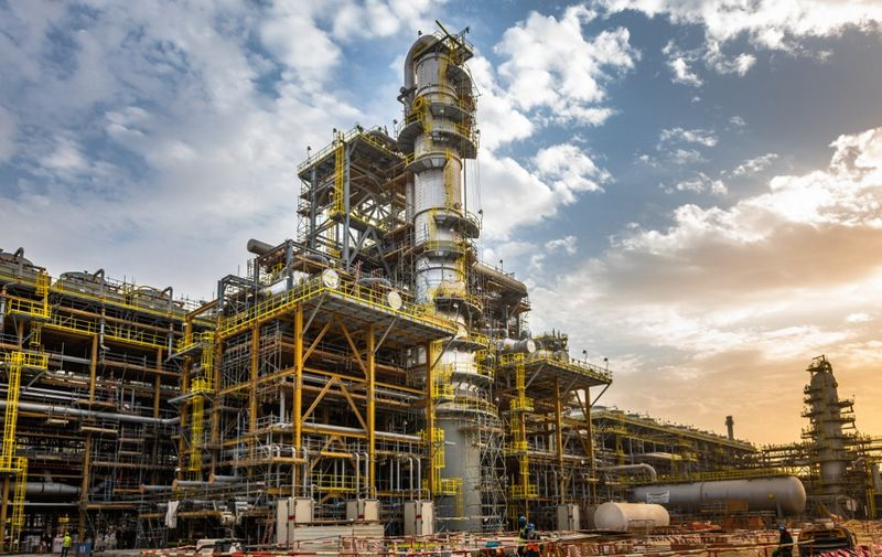 """A handout picture provided by Energy giant Saudi Aramco, Saudi Arabia's Oil Company, shows its Fadhili Gas Plant Project, located 30 km west of the city of Jubail in the eastern province of Saudi Arabia on January 16, 2019. - Aramco posted on May 12, 2020 a 25 percent slump in first-quarter profit and said the coronavirus crisis which triggered a crash in oil prices would weigh heavily on demand in the year ahead. (Photo by Mohamed ALEBN ALSHAIKH / Saudi Aramco / AFP) / === RESTRICTED TO EDITORIAL USE - MANDATORY CREDIT """"AFP PHOTO / HO /ARAMCO"""" - NO MARKETING NO ADVERTISING CAMPAIGNS - DISTRIBUTED AS A SERVICE TO CLIENTS ==="""