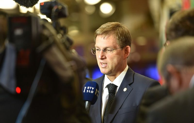 Slovenia's Prime minister Miro Cerar addresses the media as he arrives for the second day of an EU - Summit at the EU headquarters in Brussels on June 29, 2016. European Union leaders will on June 29, 2016 assess the damage from Britain's decision to leave the bloc and try to prevent further disintegration, as they meet for the first time without a British representative. / AFP PHOTO / PHILIPPE HUGUEN