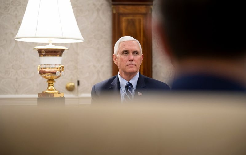 US Vice President Mike Pence listens as Texas's Governor Greg Abbott and US President Donald Trump speak to the press after a meeting in the Oval Office of the White House May 7, 2020, in Washington, DC. (Photo by Brendan Smialowski / AFP)