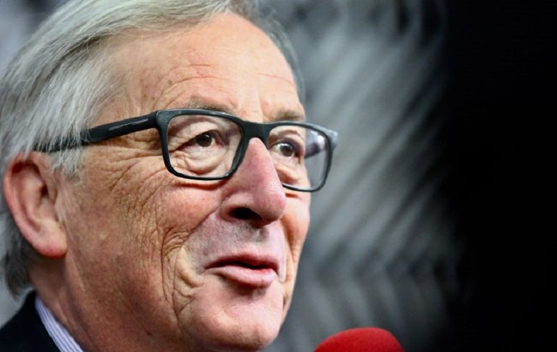 European Commission President Jean-Claude Juncker speaks to journalists as he arrives for an ?EU Eastern Partnership summit with six eastern partner countries at the European Council in Brussels on November 24, 2017. Leaders from the EU and six former Soviet states meet in Brussels on November 24 for the latest summit aimed at deepening ties, but thorny subjects like Russian influence and the war in Ukraine are off the agenda. / AFP PHOTO / Aurore BELOT