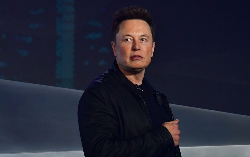 Tesla co-founder and CEO Elon Musk introduces the newly unveiled all-electric battery-powered Tesla Cybertruck at Tesla Design Center in Hawthorne, California on November 21, 2019. (Photo by Frederic J. BROWN / AFP)
