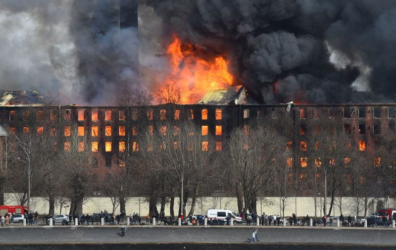 Smoke and flames rise from a burning historic factory in Saint Petersburg on April 12, 2021. (Photo by Olga MALTSEVA / AFP)
