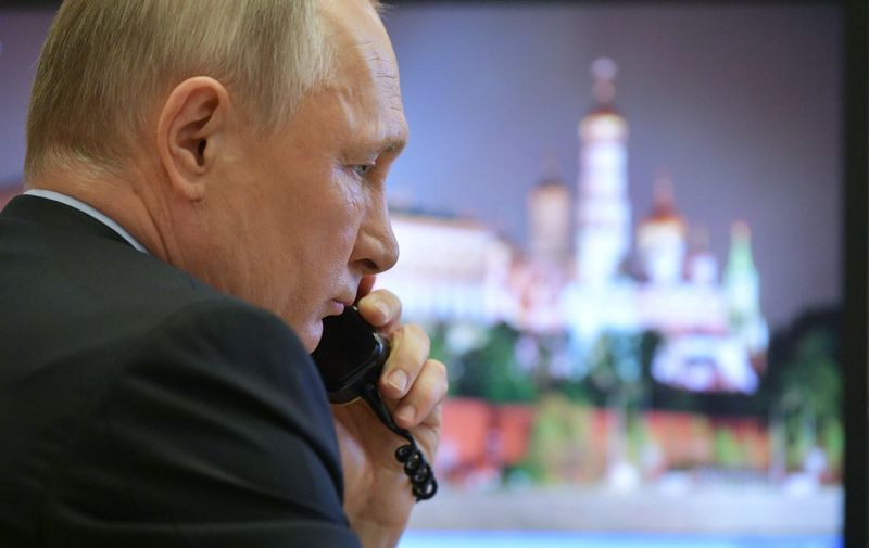 Russian President Vladimir Putin attends a meeting on the situation with the spread of the COVID-19 coronavirus disease in Russia, via a teleconference call at the Novo-Ogaryovo state residence outside Moscow on April 13, 2020. (Photo by Alexey DRUZHININ / SPUTNIK / AFP)