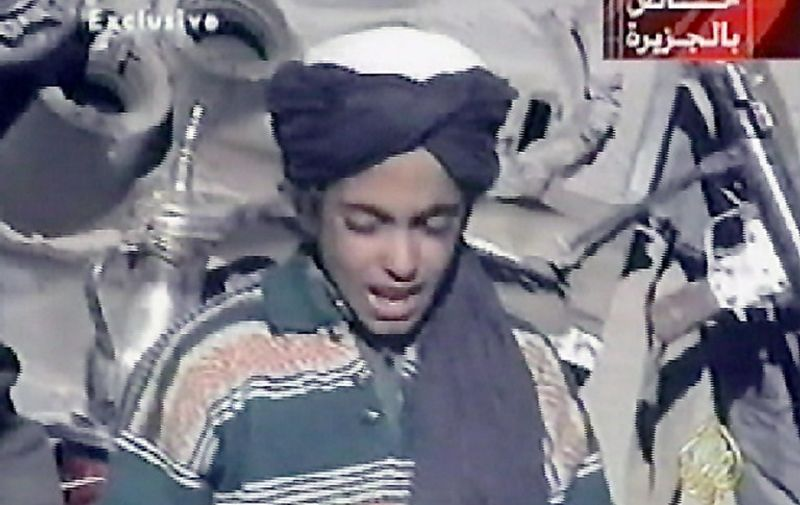 """Hamza, who appears to be the youngest son of prime terror suspect Saudi born Osama bin Laden, recites a poem extolling Kabul and Mullah Mohammad Omar, supreme leader of Afghanistan's Taliban rulers, in this frame grab taken from the Qatar based al-Jazeera satellite news channel 07 November 2001. Bin Laden's four sons accompanying Taliban and """"Afghan Arab"""" fighters on a search of a purported US base in central Afghanistan were shown on the news channel. Bin Laden is the suspected of being behind the 11 September 2001 suicide attack on two US cities. AFP PHOTO/AL-JAZEERA"""
