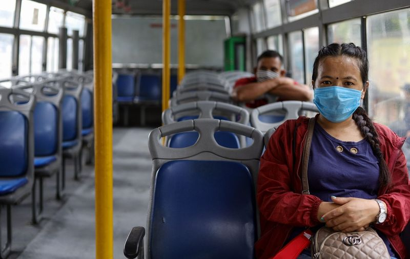 Passengers wearing a face mask and maintaining social distancing in the bus. Passengers will get access to sanitizer and mask is compulsory. Coronavirus outbreak, Kathmandu, Nepal - 16 Jul 2020,Image: 543796199, License: Rights-managed, Restrictions: , Model Release: no