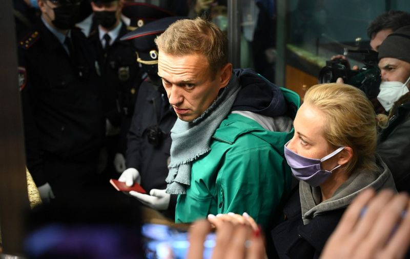 Russian opposition leader Alexei Navalny and his wife Yulia are seen at the passport control point at Moscow's Sheremetyevo airport on January 17, 2021. - Russian police detained Kremlin critic Alexei Navalny at a Moscow airport shortly after he landed on a flight from Berlin, an AFP journalist at the scene said. (Photo by Kirill KUDRYAVTSEV / AFP)