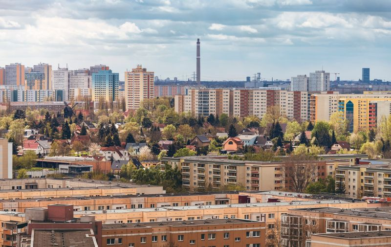 Idyllic housing estate with windmill surrounded by high-rise buildings in berlin marzahn hellersdorf,Image: 622192077, License: Royalty-free, Restrictions: , Model Release: yes, Credit line: Profimedia