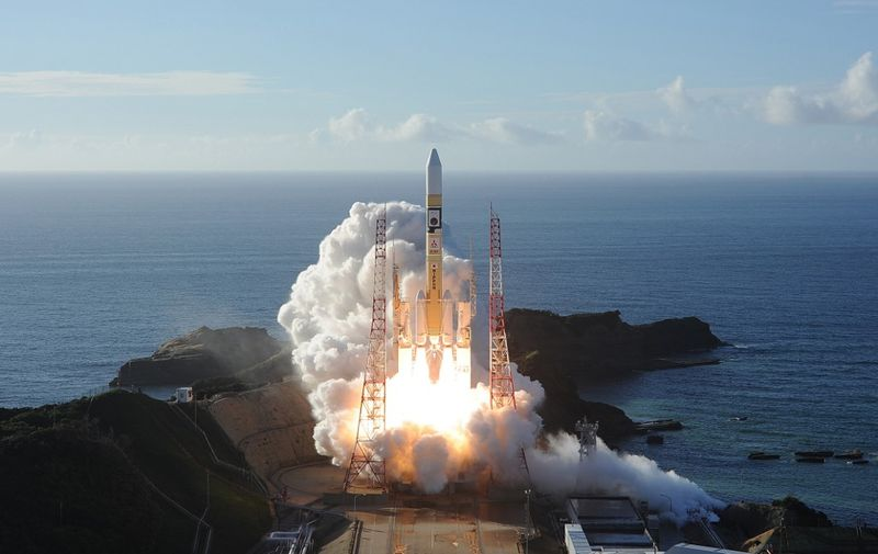 """In this handout photograph taken and released on July 20, 2020 by Mitsubishi Heavy Industries an H-2A rocket carrying the Hope Probe known as """"Al-Amal"""" in Arabic, developed by the Mohammed Bin Rashid Space Centre (MBRSC) in the United Arab Emirates (UAE) to explore Mars, blasts off from Tanegashima Space Centre in southwestern Japan. - The first Arab space mission to Mars blasted off on July 20 aboard a rocket from Japan, with the probe dubbed """"Hope"""" successfully separating about an hour after liftoff. (Photo by Handout / Mitsubishi Heavy Industries / AFP) / --- RESTRICTED TO EDITORIAL USE - MANDATORY CREDIT """"AFP PHOTO / (MITSUBISHI HEAVY INDUSTRIES)"""" - NO MARKETING NO ADVERTISING CAMPAIGNS - DISTRIBUTED AS A SERVICE TO CLIENTS ---"""