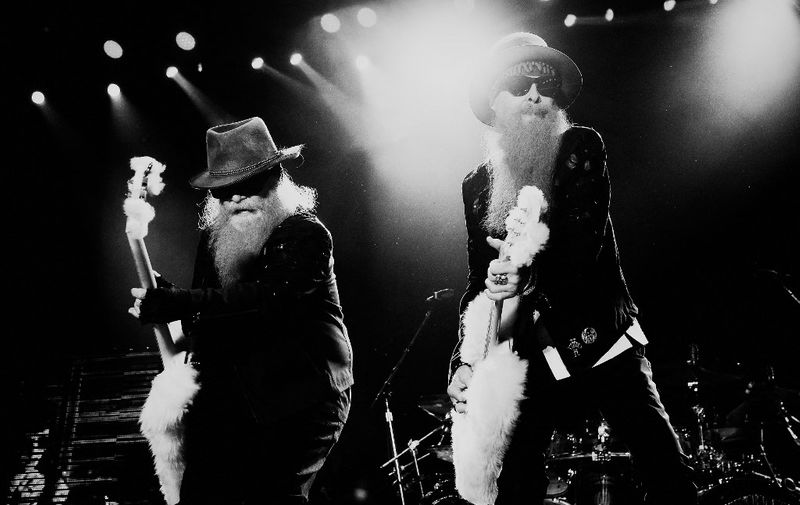 INDIO, CA - APRIL 26: (Editors Note: Image converted from color to B W). Musicians Dusty Hill (L) and Billy Gibbons of ZZ Top perform onstage during day two of 2015 Stagecoach Of The 2015 Stagecoach California's Country Music Festiva at The Empire Polo Club on April 26, 2015 in Indio, California.   Frazer Harrison/Getty Images for Stagecoach/AFP (Photo by Frazer Harrison / GETTY IMAGES NORTH AMERICA / Getty Images via AFP)