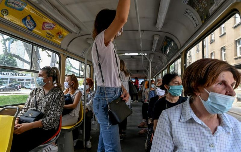 Passengers travel wearing facemasks on a tram in Zagreb on June 25, 2020, as the wearing of masks on public transport in Croatia became mandatory on June 23, due to an increase of coronavirus infections after the relaxation of lockdown conditions.,Image: 535656726, License: Rights-managed, Restrictions: , Model Release: no