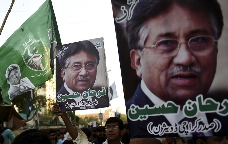Demonstrators carry pictures of former military ruler Pervez Musharraf, during a protest following a special court's verdict, in Karachi on December 24, 2019. - Exiled former Pakistani military leader Pervez Musharraf was sentenced to death on December 17 after being found guilty of treason, a verdict swiftly condemned by the armed forces which have ruled the country for almost half its 72-year history. (Photo by Rizwan TABASSUM / AFP)