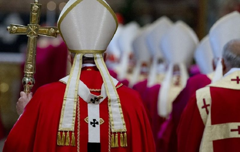 Pope Francis walks with his pastoral staff as he arrives to celebrate a Mass for cardinals and bishops who died in the past year, in St. Peter's Basilica at the Vatican, on November 3, 2015.  AFP PHOTO POOL / GREGORIO BORGIA