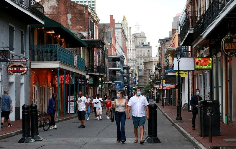 NEW ORLEANS, LOUISIANA - JULY 14: Pedestrians are seen walking along Bourbon Street in the French Quarter on July 14, 2020 in New Orleans, Louisiana. Louisiana Gov. John Bel Edwards issued three new restrictions for Phase II of reopening that will be in place until at least until July 24 across Louisiana to help prevent the spread of COVID-19. Restrictions include mandatory mask or face covering outside of the home for those eight years old and older, bars will be closed unless providing curbside pickup, and indoor social gatherings are to be limited to 50 people.   Sean Gardner/Getty Images/AFP