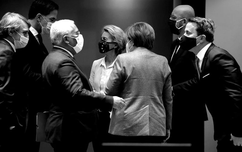 European Commission President Ursula von der Leyen, center left, and German Chancellor Angela Merkel, center right, speak with other EU heads of state during a round table meeting during an EU summit at the European Council building in Brussels, on December 10, 2020. - European Union leaders meet for a year-end summit that will address anything from climate, sanctions against Turkey to budget and virus recovery plans. Brexit will be discussed on the sidelines. (Photo by Olivier Matthys / POOL / AFP)
