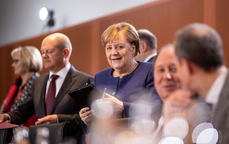 BERLIN, GERMANY - JANUARY 08: German Chancellor Angela Merkel (CDU) and Finance Minister and Vice Chancellor Olaf Scholz arrive to a first government cabinet meeting of 2020 in the German Chancellery on January 08, 2020 in Berlin, Germany. (Photo by Maja Hitij/Getty Images)