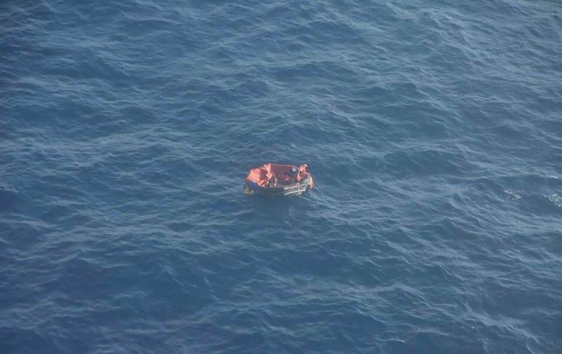 """This screengrab taken on September 30, 2019,  from an image on the official Twitter account of France's Marine Nationale, shows an aerial view of an inflatable rescue dinghy from the vessel 'Bourbon Rhode' at an undisclosed location at sea on September 28, 2019. - The Bourbon Rhode, a tug flying the Luxembourg flag, sank in the Atlantic after being inundated with water on September 26, 2019, while close to a category 4 hurricane. Three crew members were found  on September 28, aboard a liferaft by rescue teams from a commercial vessel which was diverted to rescue them by authorities. The search carried out by the Regional Operational Centre for Surveillance and Rescue (Cross) West Indies-Guyana and the French Navy to find the 11 crew members """"continues to be carried out"""", the statement said. (Photo by HO / AFP) / RESTRICTED TO EDITORIAL USE - MANDATORY CREDIT """"AFP PHOTO / MARINE NATIONALE TWITTER ACCOUNT"""" - NO MARKETING - NO ADVERTISING CAMPAIGNS - DISTRIBUTED AS A SERVICE TO CLIENTS"""