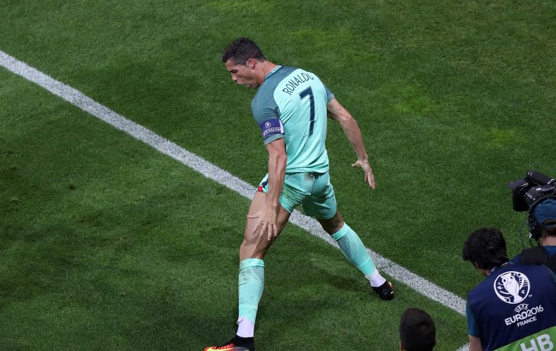LYON, FRANCE - JULY 6: Cristiano Ronaldo of Portugal celebrates after scoring a goal during the UEFA Euro 2016 semi final match between Portugal and Wales at Stade de Lyon in Lyon, France on July 6, 2016. Metin Pala / Anadolu Agency