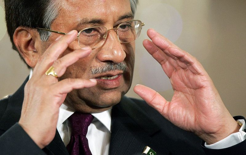 "Pakistani President Pervez Musharaff speaks during a joint press conference with US President George W. Bush in the East Room of the White House 22 September 2006 in Washington, DC. Musharraf said Friday that a peace deal between Pakistan and tribal elders along the border with Afghanistan was ""a holistic approach"" to fighting the Taliban militia. Rejecting what he called misperception that the militants would find easier refuge in border regions by the deal, he said, ""I explained to the president that this is a holistic approach that we are taking to fighting terrorism in Pakistan, in the tribal (areas) of Pakistan."" (Photo by TIM SLOAN / AFP)"