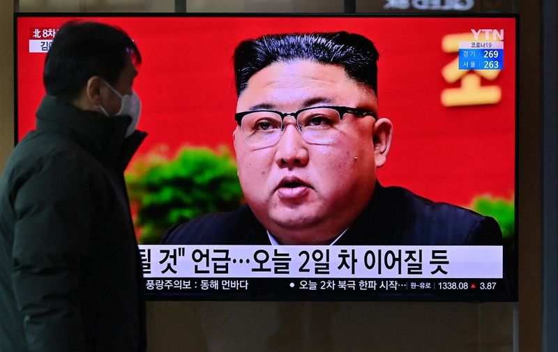 A man watches a television screen showing news footage of North Korean leader Kim Jong Un attending the 8th congress of the ruling Workers' Party held in Pyongyang, at a railway station in Seoul on January 6, 2021. (Photo by Jung Yeon-je / AFP)