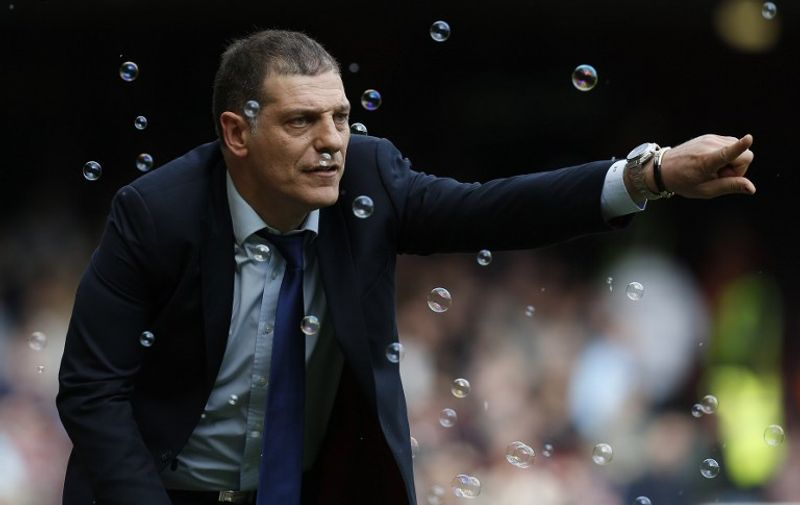 West Ham United's Croatian manager Slaven Bilic shouts instructions to his players from the touchline during the English Premier League football match between West Ham United and Arsenal at The Boleyn Ground in Upton Park, in east London on April 9, 2016. / AFP PHOTO / Ian Kington / RESTRICTED TO EDITORIAL USE. No use with unauthorized audio, video, data, fixture lists, club/league logos or 'live' services. Online in-match use limited to 75 images, no video emulation. No use in betting, games or single club/league/player publications.  /