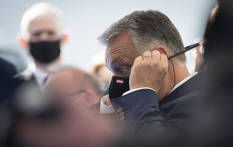 Hungarian Prime Minister Viktor Orban adjusts his headphones as he attends the opening ceremony for the start of works to build the electric power line Cirkovce-Pince start, in Kidricevo, Slovenia on October 14, 2020. (Photo by Jure Makovec / AFP)