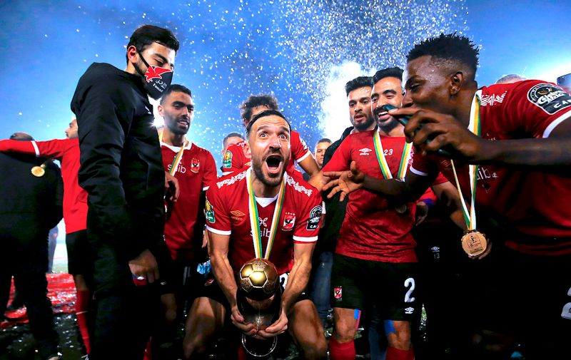 Soccer Football - African Champions League Final - Zamalek v Al Ahly - Cairo International Stadium, Cairo, Egypt - November 27, 2020  Al Ahly's Ali Maaloul celebrates with the trophy and teammates after winning the final REUTERS/Amr Abdallah Dalsh