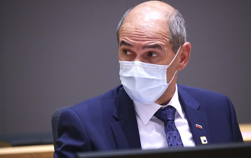 Slovenian Prime Minister Janez Jansa wearing face mask attends during the two days European Union (EU) summit at the European Council Building in Brussels, on October 15, 2020. - European leaders meet to re-examine the post-Brexit talks under pressure from English Prime Minister to give ground or see Britain walk away with no trade deal. (Photo by YVES HERMAN / POOL / AFP)