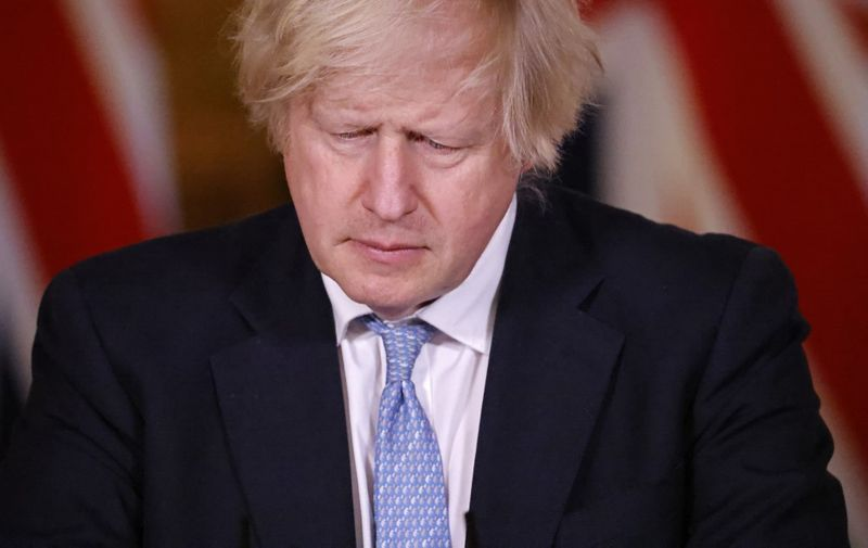 Britain's Prime Minister Boris Johnson gives an update on the coronavirus Covid-19 pandemic during a virtual press conference inside 10 Downing Street in central London on March 18, 2021. (Photo by Tolga Akmen / POOL / AFP)