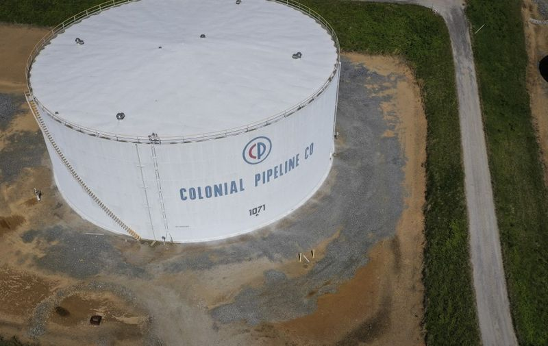WOODBINE, MD - MAY 13: In an aerial view, fuel holding tanks are seen at Colonial Pipeline's Dorsey Junction Station on May 13, 2021 in Washington, DC. The Colonial Pipeline has returned to operations following a cyberattack that disrupted gas supply for the eastern U.S. for days.   Drew Angerer/Getty Images/AFP (Photo by Drew Angerer / GETTY IMAGES NORTH AMERICA / Getty Images via AFP)