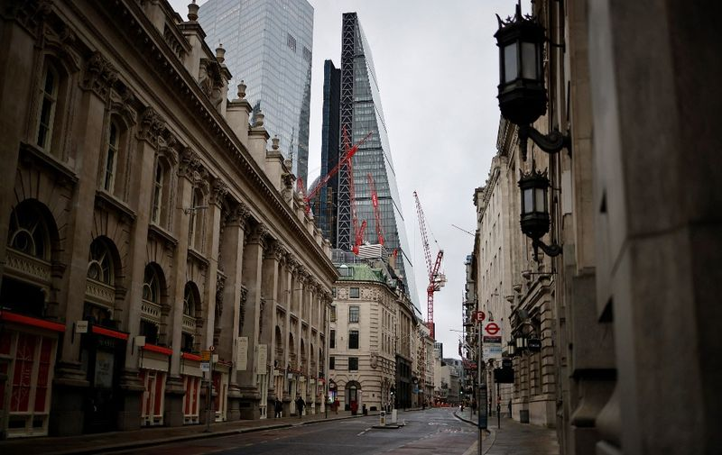 """An empty Cornhill street is pictured, with the Leadenhall Building, commonly called the """"Cheesegrater, in the background, in the City of London, as Britain enters a national lockdown in London on January 5, 2021. - England's six-week lockdown, which began at midnight, emulates the first national coronavirus curbs in place from March to June -- but goes further than another instituted in November when schools remained open. Authorities in Wales, Scotland and Northern Ireland have all taken similar measures, putting the UK as a whole in lockdown. (Photo by Tolga Akmen / AFP)"""