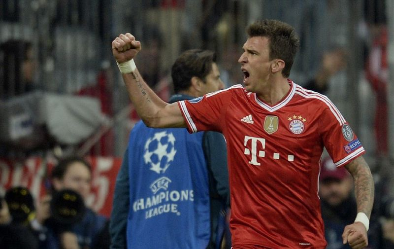 Bayern's Mario Mandzukic of Croatia reacts during the UEFA Champions League quarter-final second leg football match Bayern Munich vs Manchester United in Munich, southern Germany, on April 9, 2014.  AFP PHOTO / JOHANNES EISELE (Photo by JOHANNES EISELE / AFP)