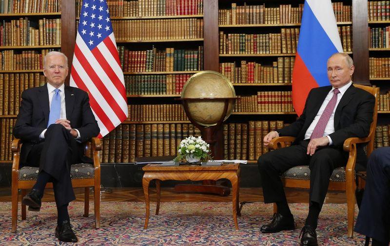 US President Joe Biden (R) meets with Russian President Vladimir Putin (L) at the 'Villa la Grange' in Geneva on June 16, 2021. (Photo by DENIS BALIBOUSE / POOL / AFP)