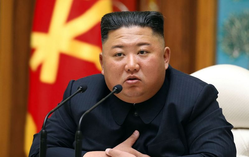 """(FILES) This file picture taken on April 11, 2020 and released from North Korea's official Korean Central News Agency (KCNA) on April 12, 2020 shows North Korean leader Kim Jong Un speaks during a meeting of the Political Bureau of the Central Committee of the Workers' Party of Korea (WPK) in Pyongyang. - North Korean leader Kim Jong Un apologised on September 25, 2020 over the killing of a South Korean at sea, calling it an """"unexpected and disgraceful event"""", Seoul's presidential office said. (Photo by STR / KCNA VIA KNS / AFP) / South Korea OUT / ---EDITORS NOTE--- RESTRICTED TO EDITORIAL USE - MANDATORY CREDIT """"AFP PHOTO/KCNA VIA KNS"""" - NO MARKETING NO ADVERTISING CAMPAIGNS - DISTRIBUTED AS A SERVICE TO CLIENTS / THIS PICTURE WAS MADE AVAILABLE BY A THIRD PARTY. AFP CAN NOT INDEPENDENTLY VERIFY THE AUTHENTICITY, LOCATION, DATE AND CONTENT OF THIS IMAGE --- /"""
