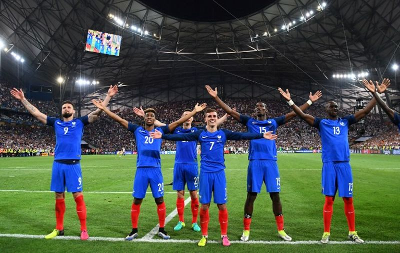 From left: France's forward Olivier Giroud, forward Kingsley Coman, defender Laurent Koscielny,  forward Antoine Griezmann, midfielder Paul Pogba, France's defender Eliaquim Mangala celebrate after beating Germany 2-0 in the Euro 2016 semi-final football match between Germany and France at the Stade Velodrome in Marseille on July 7, 2016. France will face Portugal in the Euro 2016 finals on July 10, 2016. / AFP PHOTO / FRANCK FIFE
