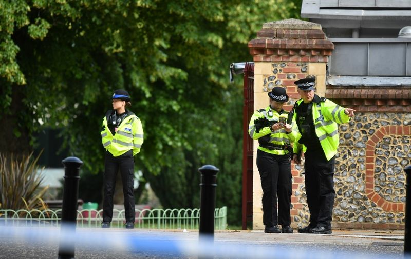 Police officers secure a police cordon near Forbury Gardens park in Reading, west of London, on June 20, 2020 following a stabbing incident the previous day. - British police said Sunday they were keeping an open mind about what prompted a lone suspect to stab three people to death in a park filled with families and friends relaxing in the southern English city of Reading. (Photo by Ben STANSALL / AFP)