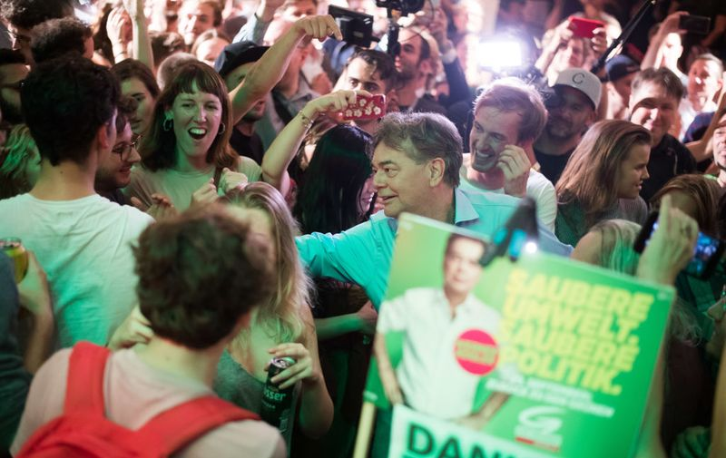 """VIENNA, AUSTRIA - SEPTEMBER 29: Werner Kogler of the Austrian Greens Party arrives and celebrates with supporters at an election party of the Greens during the National Council elections on September 29, 2019 in Vienna, Austria. The elections are taking place following the so-called Ibiza affair, which brought down then Vice-Chancellor and leader of the FPOe, Heinz-Christian Strache, but also eventually led to the dissolution of the entire government. The Austrian People""""u2019s Party of former Chancellor Sebastian Kurz is leading solidly in polls going into the election with the Social Democrats (SPOe) and Freedom Party (FPOe) in second and third place, respectively. In fourth place and with likely the biggest points gain is the Austrian Greens party. (Photo by Michael Gruber/Getty Images)"""