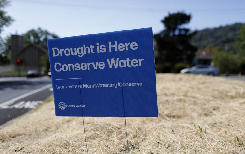 SAN ANSELMO, CALIFORNIA - APRIL 23: A sign advocating water conservation is posted in a field of dry grass on April 23, 2021 in San Anselmo, California. As the worsening drought takes hold in the state of California, Marin County became the first county in the state to impose mandatory water-use restrictions that are set to take effect May 1. Residents will be ordered to refrain from washing cars at home, refilling pools and watering lawns will only be allowed once a week. Earlier this week, California Gov. Gavin Newsom declared a drought emergency in Sonoma and Mendocino counties.   Justin Sullivan/Getty Images/AFP (Photo by JUSTIN SULLIVAN / GETTY IMAGES NORTH AMERICA / Getty Images via AFP)