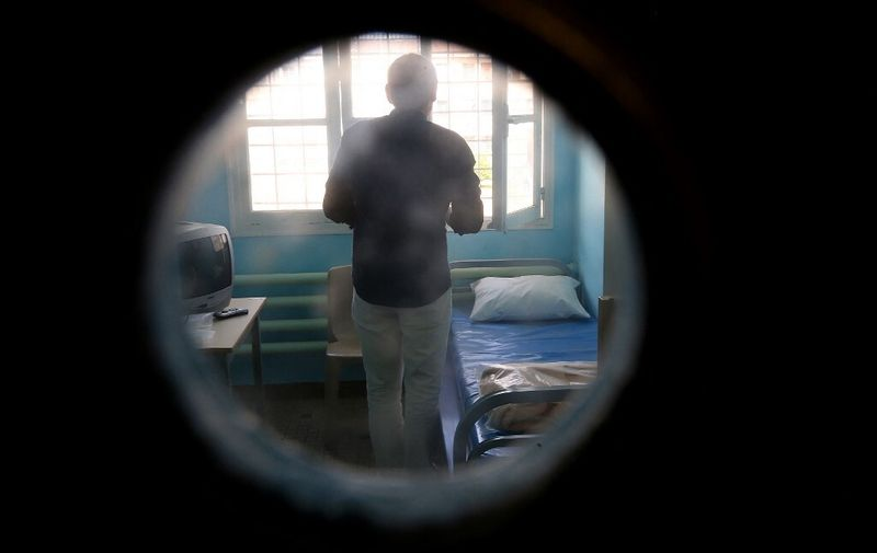 An inmate stands in his cell at Clairvaux Prison in Ville-sous-la-Ferte, northwestern France, on August 4, 2015. AFP PHOTO / FRANCOIS NASCIMBENI (Photo by FRANCOIS NASCIMBENI / AFP)