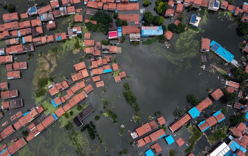 An aerial view shows flooded residential buildings due to rising water levels of the Yangtze river in Jiujiang, China's central Jiangxi province, on July 18, 2020. - Vast swathes of China have been inundated by the worst flooding in decades along the Yangtze River, with residents piling into boats and makeshift rafts to escape a deluge that has collapsed flood defences and turned homes into waterways. (Photo by Hector RETAMAL / AFP)
