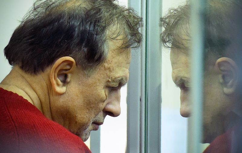 Russian professor Oleg Sokolov stands behind glass as he attends a court hearing in Saint Petersburg on November 11, 2019, after the historian confessed to the murder and the dismembering of his former student lover. Oleg Sokolov, a 63-year-old history lecturer was arrested on November 9, 2019, on suspicion of murder after he was hauled out of the icy Moika River with a backpack containing a woman's arms. Sokolov was reportedly drunk and fell into the Moika, a tributary of the Neva, in central Saint Petersburg as he tried to dispose of body parts near the offices of investigators., Image: 482254898, License: Rights-managed, Restrictions: , Model Release: no, Credit line: Olga MALTSEVA / AFP / Profimedia