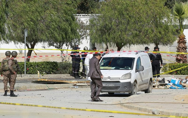 Police and forensic experts inspect the scene of an explosion near the US embassy in the Tunisian capital Tunis on March 6, 2020. - A double suicide attack shook the Tunisian capital as assailants wounded six people including police guarding the US embassy, authorities said. An explosion rocked the Berges du Lac district where the embassy is located around midday, causing panic among pedestrians and motorists in the area. Two assailants died in the attack, the first to hit the capital since June 2019, according to officials. (Photo by Anis MILI / AFP)