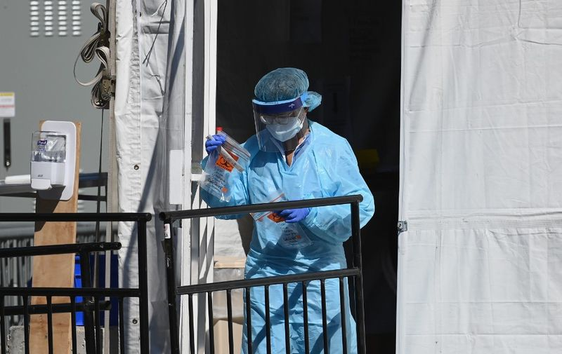 A medical worker walks out of a coronavirus, COVID-19, testing tent at Brooklyn Hospital Center on March 27, 2020 in New York City. (Photo by Angela Weiss / AFP)
