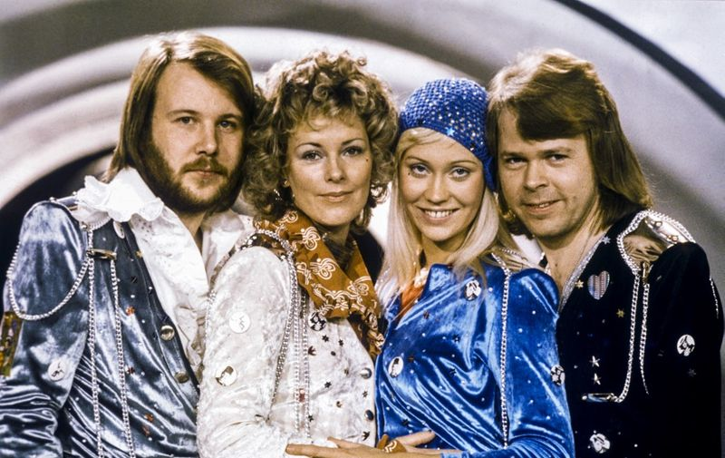 """Picture taken in 1974 in Stockholm shows the Swedish pop group Abba with its members (L-R) Benny Andersson, Anni-Frid Lyngstad, Agnetha Faltskog and Bjorn Ulvaeus posing after winning the Swedish branch of the Eurovision Song Contest with their song """"Waterloo"""". - Sweden's legendary disco group ABBA announced on April 27, 2018 that they have reunited to record two new songs, 35 years after their last single. The quartet split up in 1982 after dominating the disco scene for more than a decade with hits like """"Waterloo"""", """"Dancing Queen"""", """"Mamma Mia"""" and """"Super Trouper"""". (Photo by Olle LINDEBORG / TT News Agency / AFP) / Sweden OUT"""