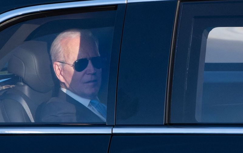 US President Joe Biden sits in a limousine to join the airport after the US-Russia summit in Geneva on June 16, 2021. (Photo by SEBASTIEN BOZON / AFP)