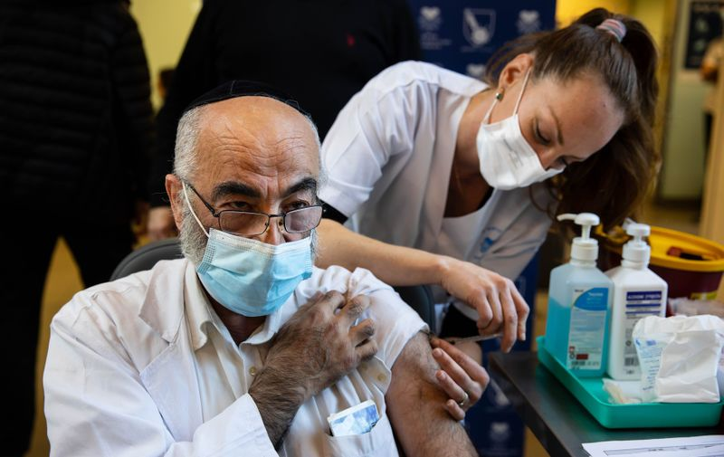 December 20, 2020 - Tel Aviv, Israel: First day of vaccinating medical staff at Sourasky Medical Center in Tel Aviv with Pfizer Covid-19 vaccine. The medical staff in the hospitals are the first to get the vaccine for Covid-19.,Image: 577504033, License: Rights-managed, Restrictions: No publication in Israel, Model Release: no
