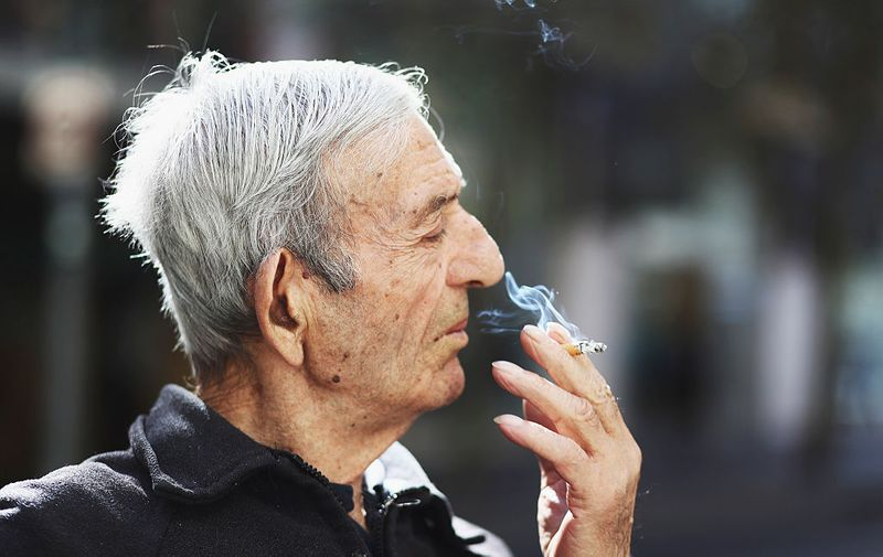 SYDNEY, AUSTRALIA - MAY 04:  A man smokes a cigarette on May 04, 2016 in Sydney, New South Wales.The Australian Government yesterday announced in their budget four annual 12.5 per cent increases to tobacco excise and excise equivalent customs duties which will significantly push up the over-the counter price up to AUD$40 by 2020.  (Photo by Ryan Pierse/Getty Images)