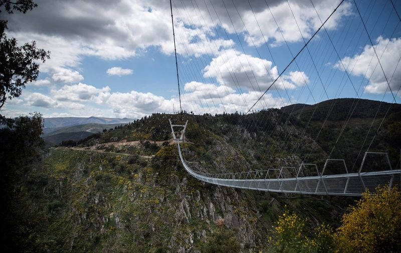 A general view shows the 516 Arouca Bridge, the world's longest pedestrian suspension bridge with a length of 516 metres and a height of 175 metres, in Arouca in northern Portugal on April 29, 2021. (Photo by CARLOS COSTA / AFP)