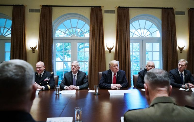 US President Donald Trump, flanked by Defense Secretary James Mattis (L), and Chief of Staff John Kelly (R), hold a meeting with senior military leaders in the Cabinet Room of the White House on October 5, 2017. (Photo by Mandel NGAN / AFP)